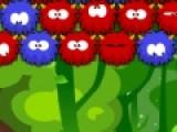Перед тобой интересная игра про разноцветных чудиков. Твоя задача не дать им добраться до самого низа игрового поля. Для этого используй специальную дробилку. Она стреляет такими же чудиками. Когда чудиков одного цвета соберется в группе дольше трех, они лопнут как пузыри.